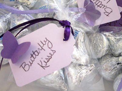 FAVORS? Butterfly kisses wrapped in tulle, tied with yarn, thank you tag attached