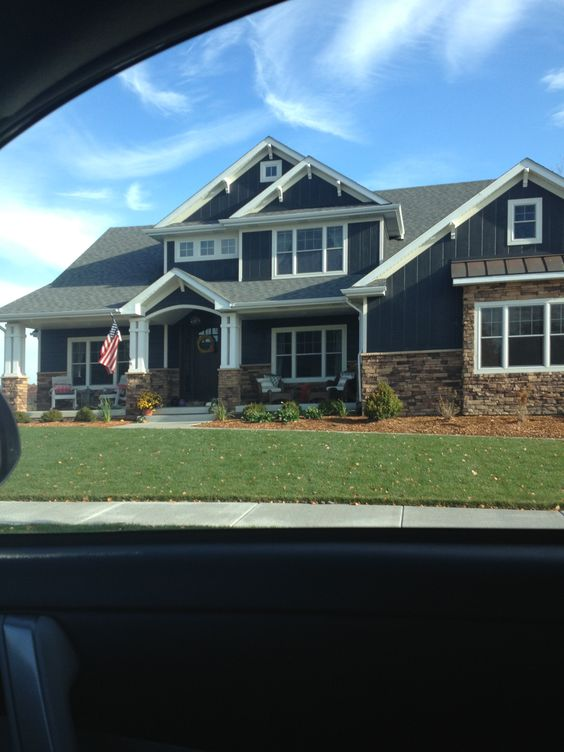Love the dark blue siding dark brown brick and white for Exterior home accents