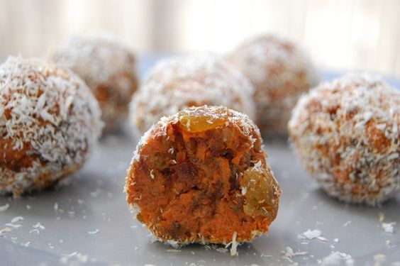 These healthy, raw, vegan, gluten-free, refined sugar free cake balls are a  taste of carrot cake heaven in a bite sized portion!  Carrot cake has always been one of my favorite desserts—a moist, fluffy,  sweet, and spicy cake smothered in a rich, sweet, and slightly tangy cream  cheese frosting… Not many sweets hold a candle to carrot cake in my book.  When I was a kid . . .