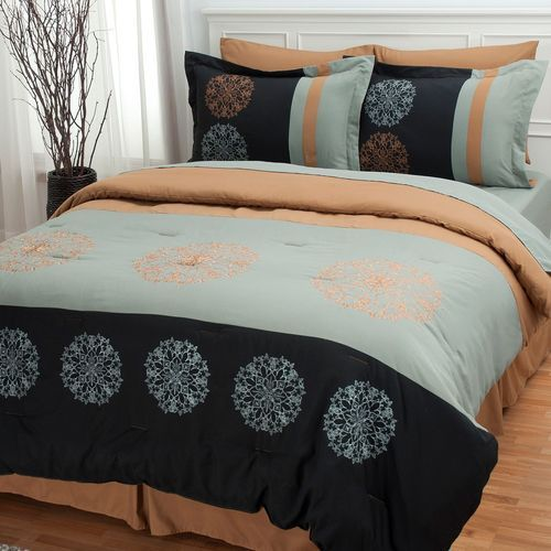 Royal Garden 8 pc Bedding Ensemble ~king. The Royal Garden bedding ensemble showcases a modern design in unique and calming tones. You will see black, muted green with blue undertones, bronze all accented by kaleidoscope embroidered designs. Make your entire bed with this set - a four-piece sheet set is also included. All pieces made from 100% polyester. Made in China.