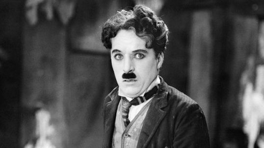 "April 15, 1953: Charlie Chaplin surrenders his U.S. re-entry permit rather than face proceedings by the U.S. Justice Department. Chaplin was accused of sympathizing with Communist groups. Chaplin, who had left the country to premiere his film ""Limelight"" in his hometown of London, would settle permanently in Switzerland and not make a return visit to America until 1972."