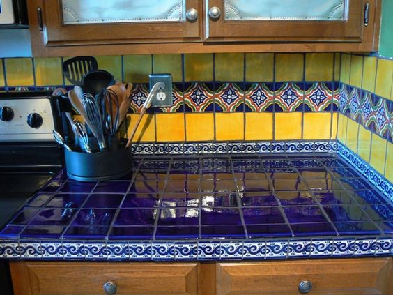 Blue yellow mexican tiles kitchen countertop and backsplash design ...
