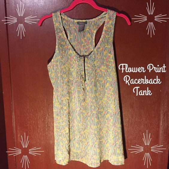 Flower Print Racerback Tank Sheer Racerback style tank in a floral print. Pleated in front with zipper that opens or closes to reveal cleavage. Light gray, pink, orange, black and white in color. In great condition, no tears or stains. Size Medium. 100% Polyester. Fire Los Angeles Tops Tank Tops
