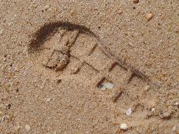 footprint in the sand at Praia do Faro in the Algarve Portugal