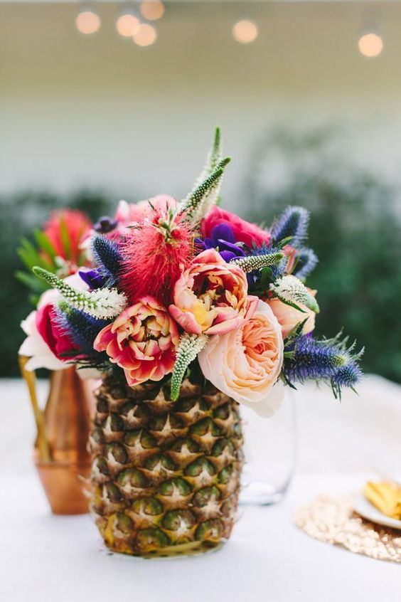 A pineapple vase is the perfect table centrepiece for a summers wedding.