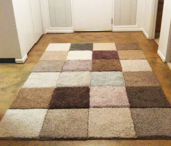 Carpet sample rug. The tutorial is here:  http://www.readymade.com/projects/carpet_sample_area_rug/next_step#steps