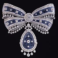 Cartier Bow Brooch----Is bow shaped, almost four inches in diameter, and completely paved with gemstones. A stunning piece.