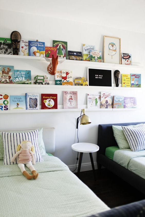 Picture ledges as bookshelves, running the length of a shared bedroom for kids: