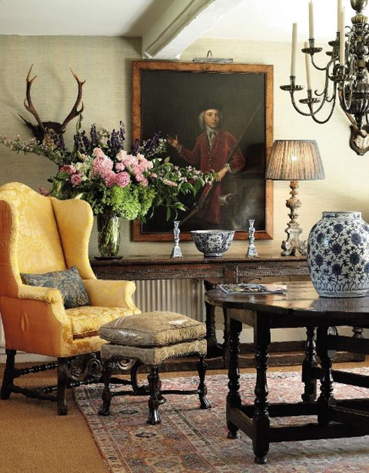 wing chair - a high back arm chair with side pieces. Similar in design to the queen anne chair.