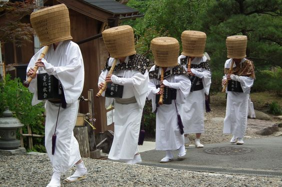 Men with baskets on their heads, playing flutes. Hurrah!