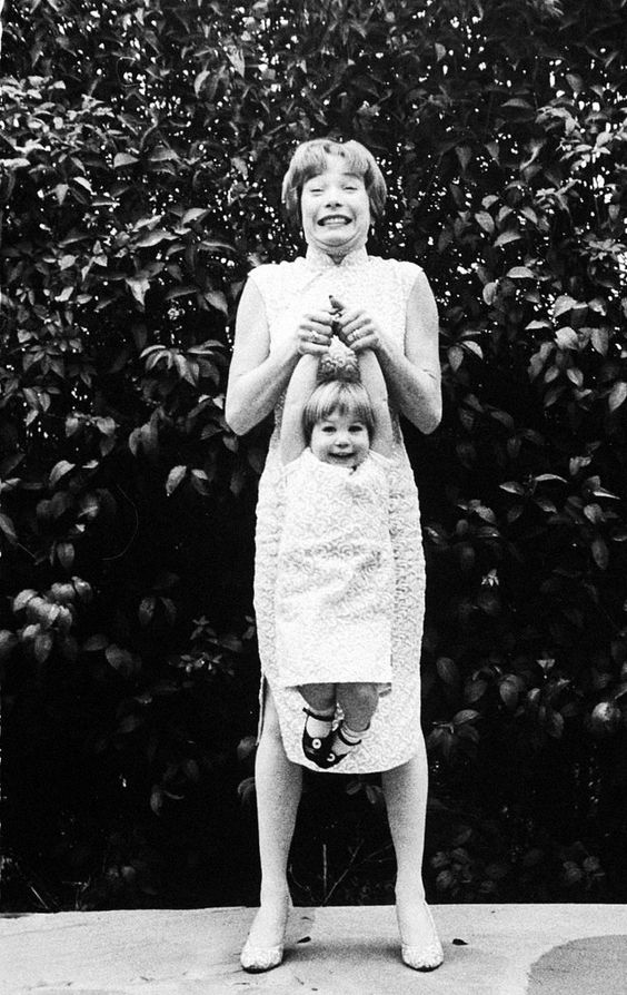 Shirley MacLaine playing with her daughter