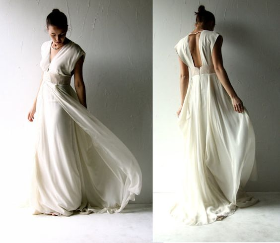 This one of a kind wedding gown has a slimming, elegant line, carefully draped and cut, and sartorially sewn.    it has cap sleeves, an open back and