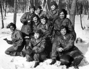 A contingent of African-American WACs poses for the camera before departing for Europe in 1945. This was the first deployment of African-American women to be sent to the war front by the United States.