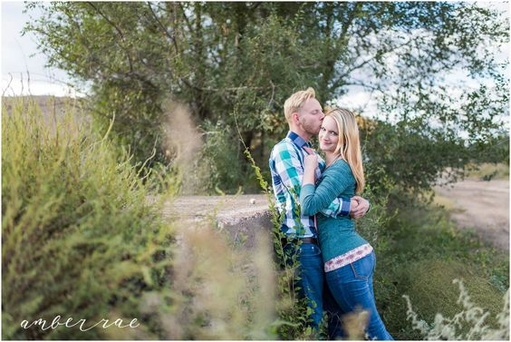 Engagement Photo Outfit Ideas. Blue green plaid, pink tie, green sweater, blue jeans.   AmberRaePhoto_Engagement_Minneapolis_MN_0009.jpg