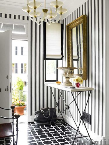 bold and graphic entry.  Block Print Stripe wallpaper by Farrow & Ball. Design: Hillary Thomas and Jeff Lincoln. Photo: Eric Piasecki.