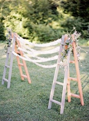 Escort Card Display With Ribbons & 2 ladders. Cute for a ceremony backdrop, too! Now....where does one find a wooden ladder or two?: