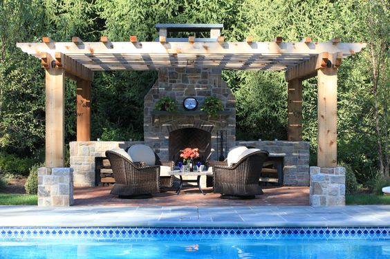 Pool pergola patio and a fireplace outdoor fireplaces for Fireplace on raised deck