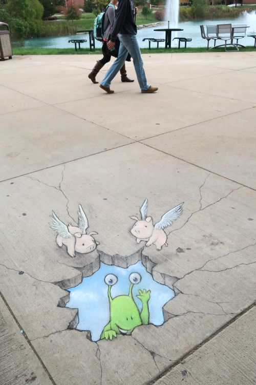 """With the right attitude (and friends with wings), even the biggest pitfall becomes a photo op."" Chalk & charcoal sidewalk installation at Eastern Michigan University."