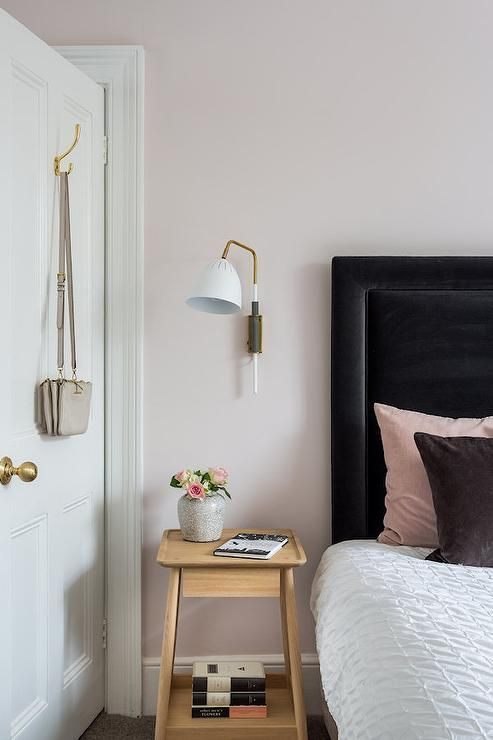 Pale Pink Bedroom With Wooden Furniture And Woven Accessories Bedroomcolor Bedroom Color Pink Black Headboard Black Headboard Bedroom Bedroom Headboard