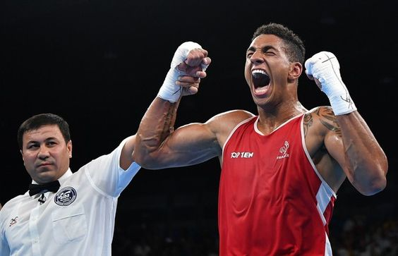 France's Tony Victor James Yoka (R) celebrates after winning against Great Britain's Joe Joyce (unseen) during the Men's Super Heavy (+91kg) Final Bout at the Rio 2016 Olympic Games at the Riocentro - Pavilion 6 in Rio de Janeiro on August 21, 2016.   / AFP / Yuri CORTEZ