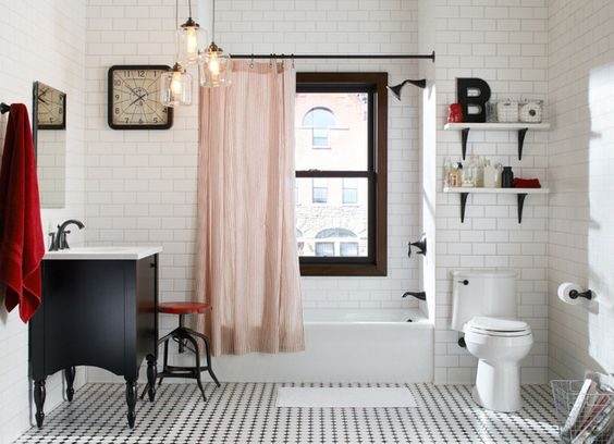a furniture-style vanity and oil-rubbed-bronze fixtures go well