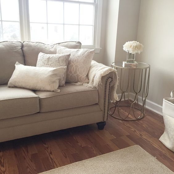 Cozy living room warm beige and whites paint color What color furniture goes with beige walls