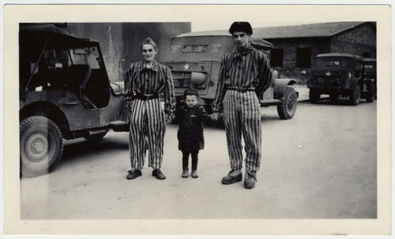 The child Josef Schleifstein poses with two survivors at Buchenwald. Josef spent three of his first four years as a prisoner in Buchenwald. Though some of the SS guards treated him as a camp mascot of sorts, Josef was lined up with other inmates for execution, and only saved by his father's last second intervention. Because the German's valued his father's leatherworking skills, Josef was allowed to survive. He and his family emigrated to the U.S. in 1947.