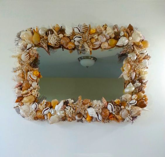 A beautiful mirror for your home featuring many types of premium quality sea shells and coral pieces in earthy tones of brown, white and beige. There are four large starfish that I covered with tiny sea shells and rice pearls as well as delicate clear Swarovski crystals to give it just a bit of sparkle. The cockle shells hold a real pearl and pieces of dark brown sea fan are placed throughout the mirror to add even more interesting texture.  Size: 50 x 35 or 4.2ft x 2.11ft  This mirror is…