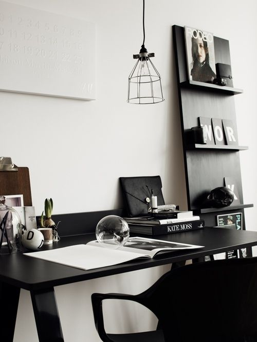 A simple scheme of black/white gives a neat and tidy vibe to this office space.