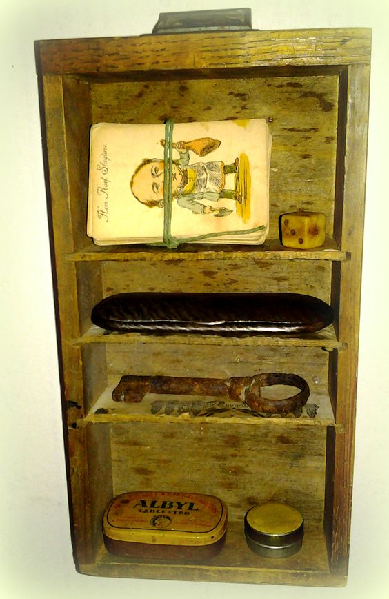 Old box shelf with some antique/vintage stuff.