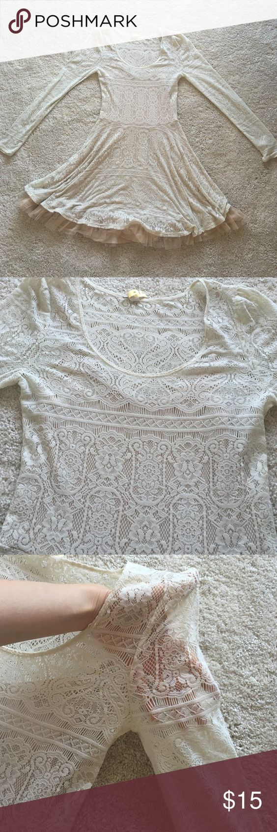 Free people tan lace dress Mini long sleeve dress with just the right amount of tulle on the skirt to make you feel like a princess but not over doing it. See pics Free People Dresses Mini