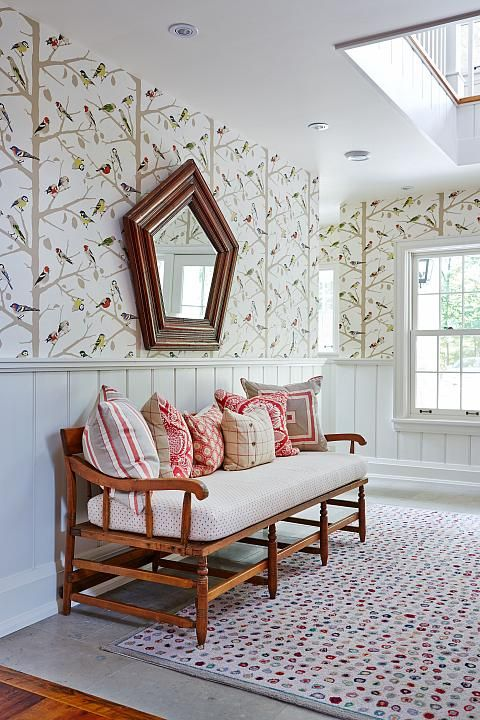 Bold bird wallpaper, vintage bench and red accents in #SarahRichardson designed hall with wainscot and #moderncountry decor