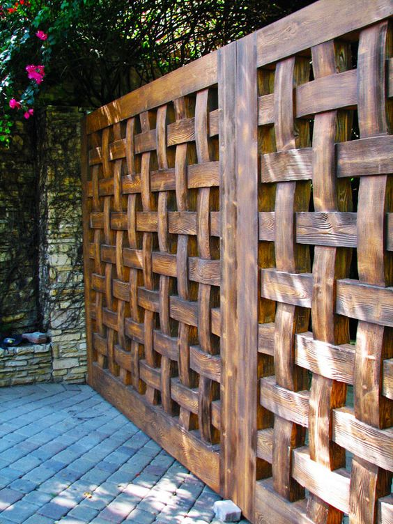 Such a good looking and substantial fence woven wood