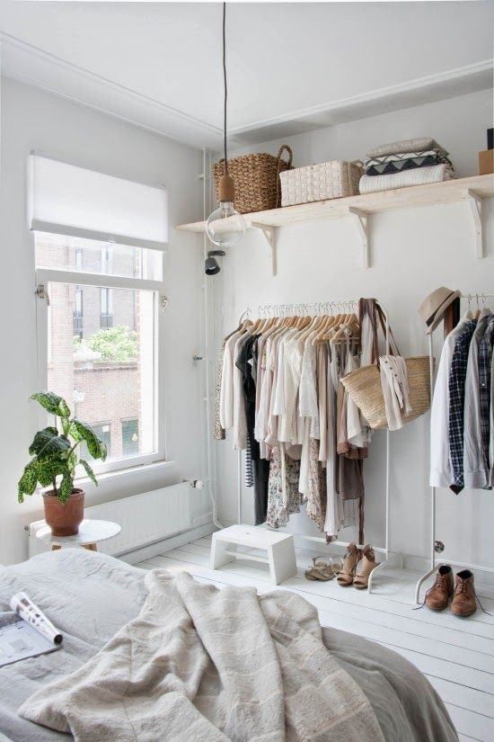 Adding shelves above clothing racks is basically like having a closet without doors. Alternatively you can attach the clothing racks to the shelves for more carpet space!