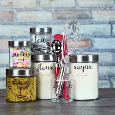 DIY clear labels made with a printer and packing tape. The font is called Digory Doodles.