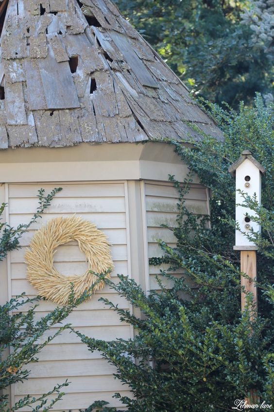 Stop by to see our fall patio and see even more beautiful outdoor spaces from my friends! #fall #falldecor #falloutdoors #fallpatio http://lehmanlane.net - garden shed wheat wreath and bird house