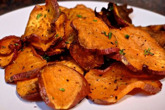 Oven Baked Yam Chips Recipe  Ingredients:  1 large yam sea salt and pepper olive oil cayenne pepper fresh thyme (optional)  Preparation:  Heat your oven to 400 degrees.