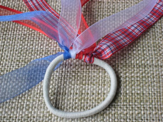 DIY ribbon hair bands:  Just tie ribbons onto an elastic rubber band and voila!  You can use any colors or ribbons that you like!