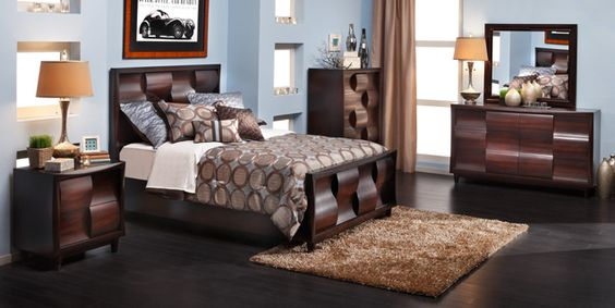 Blue paint contrasts beautifully with the  black cherry finished Wave Bedroom Group.