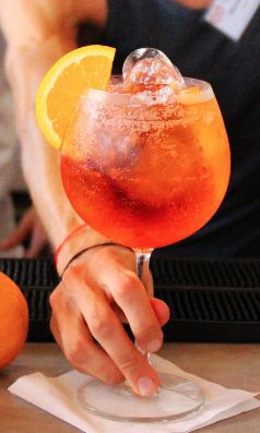 Aperol Spritz Cocktail  Recipe:  -2 oz Prosecco  -1 1/2 oz Aperol  -3/4 oz Soda  Glass: Rocks/Wine Glass  Method: Build  Ice: Cubed  Garnish: Orange Slice or Zest: