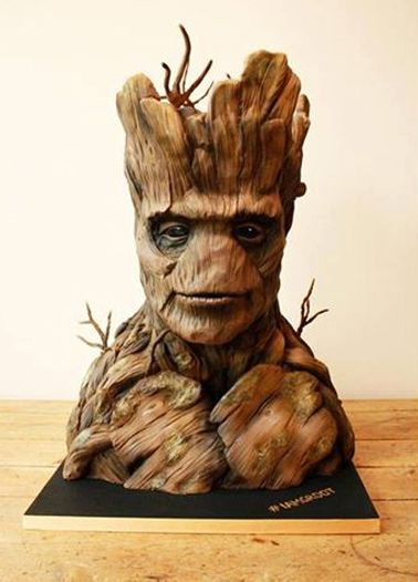 This Cake Shouts 'I Am Groot'.  Groot, our favorite alien tree creature from Marvel's Guardians of the Galaxy, has made his way to London. Tattooed Bakers of South London, UK made this amazing edible representation of this popular Marvel character. <3