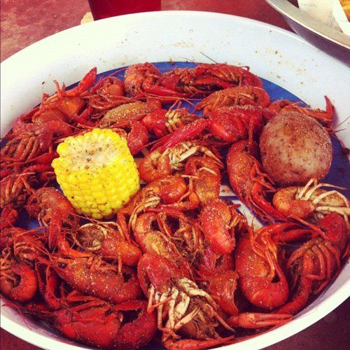 Crawfish, potatoes & corn.  In a bowl in the middle of the table, that's how we do