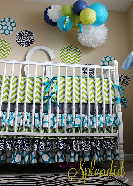 I love this ruffled crib skirt with amazing polka dots and chevron.  It is such a neutral nursery it could go boy or girl if you ask me.