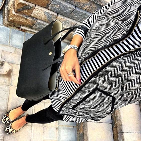 IG @mrscasual <click through to shop this look> J Crew Factory herringbone vest.  Black and white striped tunic.  Leggings.  Leopard flats.  Tory burch perry tote.