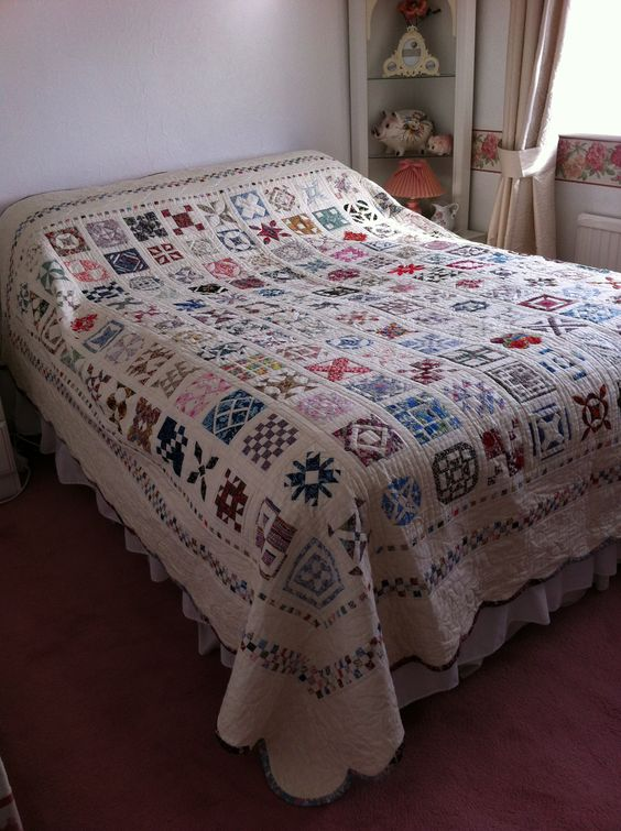 'Dear Jane' Patchwork Quilt with scalloped boarders. Finished 2011. Based on a quilt made by an American Lady during the American Civil War while her husband was away fighting.