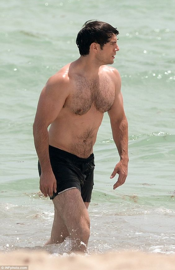 Battle of the bulk: Wearing just boardshorts the Superman V. Batman star's formidable physique got its chance to shine