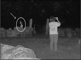 Equipment Check and Deployment - Ghost Hunting www.netplaces.com A full-body apparition caught on film by Kathy Conder at a small family graveyard in Rhode Island. Photo copyright Kathy Conder, 2005.