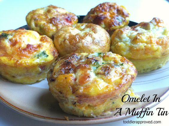 omelets in a muffin tin: bacon, shredded carrots, sauteed onions, zucchini, sweet potatoes (previously cooked), tomatoes, green onions, Mexican blend cheese    Preheat oven to 350 degrees.  Generously grease bottoms and sides of muffin tins.