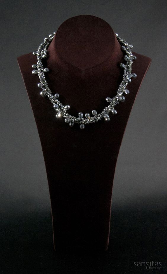 Upendo Silver - A multi-stranded charmer comprised of both briolette and teardrop shaped crystals. Versatile enough to transform day to evening wear, its sure to be a complement to any wardrobe!