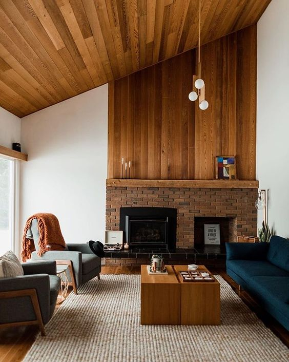 Wood paneling for the win! 🏆 @erinntreb's gorgeous living room featuring our @bowerstudios pendant! 📷: @thepaperdeerphotography #cabin #cabinvibes #woodpanelling #moderncabin #livingroomgoals